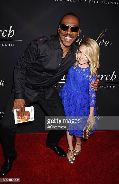 Actors Eddie Murphy and McKenna Grace arrives at the premiere of Cinelou Releasing's 'Mr Church' at ArcLight Hollywood on September 6 2016 in...