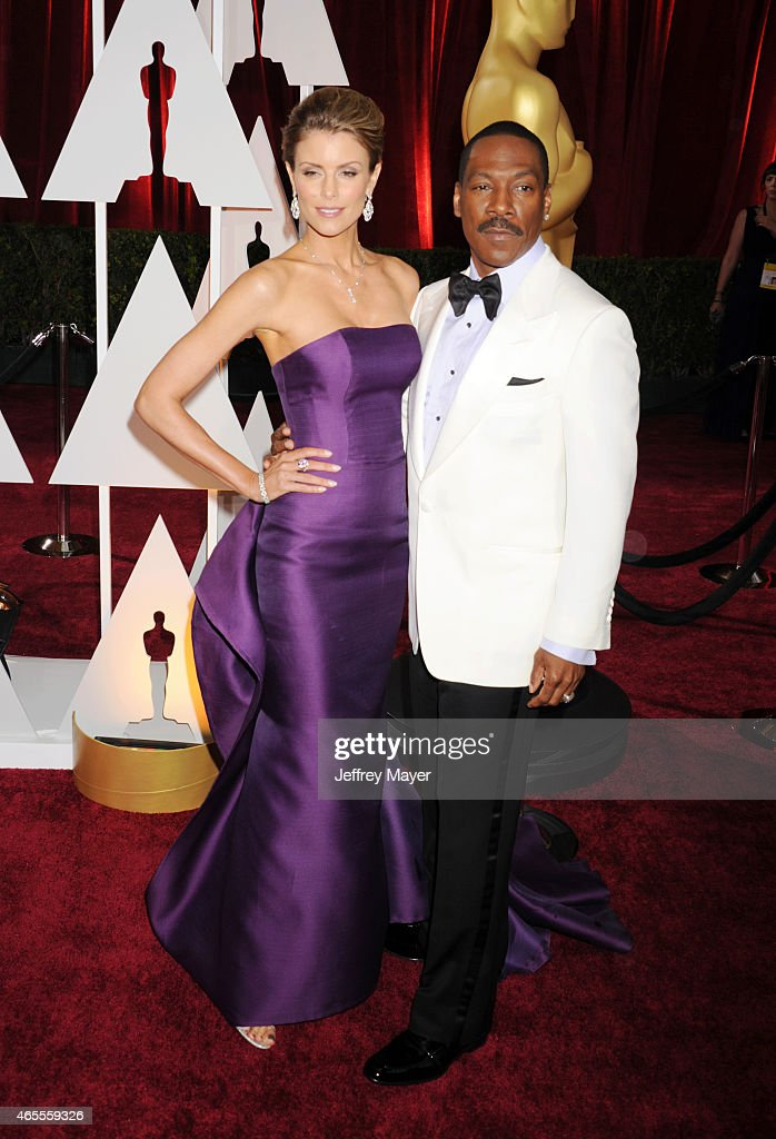 Actors Eddie Murphy (R) and Paige Butcher arrive at the 87th Annual Academy Awards at Hollywood & Highland Center on February 22, 2015 in Hollywood, California.