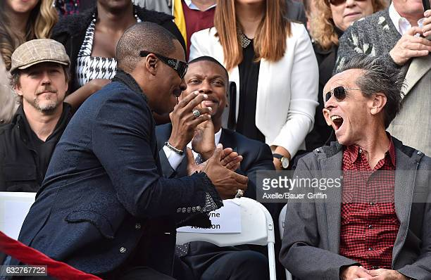 Actors Eddie Murphy Chris Tucker Edward Norton and producer Brian Grazer attend the ceremony honoring Brett Ratner with a Star on the Hollywood Walk...