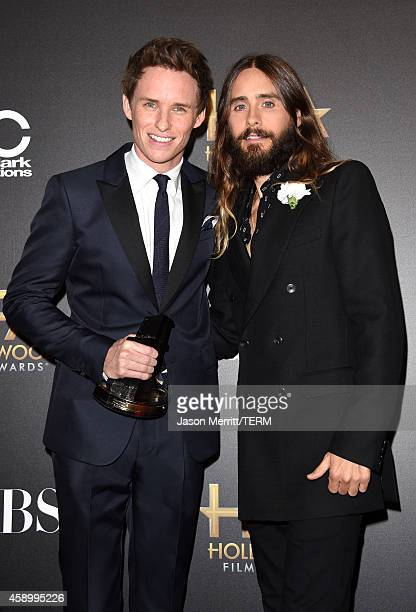 Actors Eddie Redmayne winner of Hollywood Breakout Performance for 'The Theory of Everything' and Jared Leto pose in the press room during the 18th...