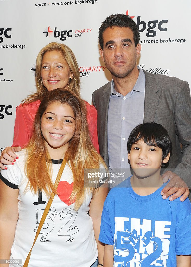 Actors Edie Falco (Rear L) and Bobby Cannavale (Rear R) pose with membrers of the 52nd Street Project at the annual charity day hosted by Cantor Fitzgerald and BGC at the BGC office on September 11, 2013 in New York City.