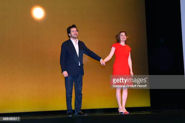 Actors Edouard Baer and Emmanuelle Devos on stage at the end of 'La Porte a Cote' Theater Play premiere Held at Theatre Edouard VII on February 10...