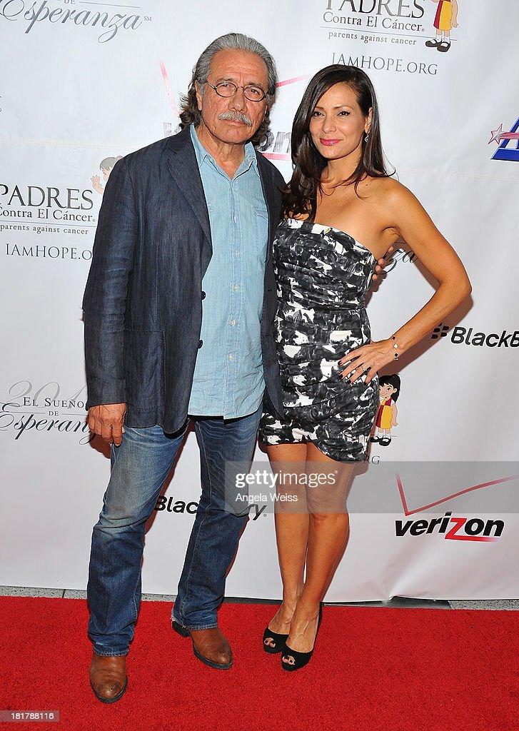 Actors Edward James Olmos (R) and Constance Marie arrive at the Padres Contra El Cancer 13th annual 'El Sueno de Esperanza' gala on September 24, 2013 in Los Angeles, California.