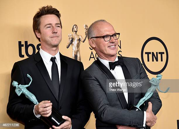 Actors Edward Norton and Michael Keaton pose in the press room at TNT's 21st Annual Screen Actors Guild Awards at The Shrine Auditorium on January 25...
