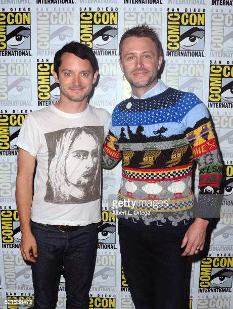 Actors Elijah Wood and Chris Hardwick pose at Dirk Gently's Holistic Detective Agency BBC America Official Panel during ComicCon International 2017...
