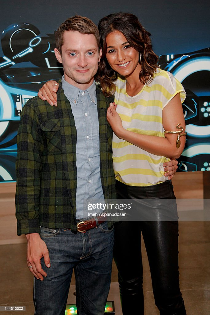 Actors <a gi-track='captionPersonalityLinkClicked' href=/galleries/search?phrase=Elijah+Wood&family=editorial&specificpeople=171364 ng-click='$event.stopPropagation()'>Elijah Wood</a> (L) and <a gi-track='captionPersonalityLinkClicked' href=/galleries/search?phrase=Emmanuelle+Chriqui&family=editorial&specificpeople=541098 ng-click='$event.stopPropagation()'>Emmanuelle Chriqui</a> attend Disney XD's 'TRON: Uprising' Press Event And Reception at DisneyToon Studios on May 12, 2012 in Glendale, California.