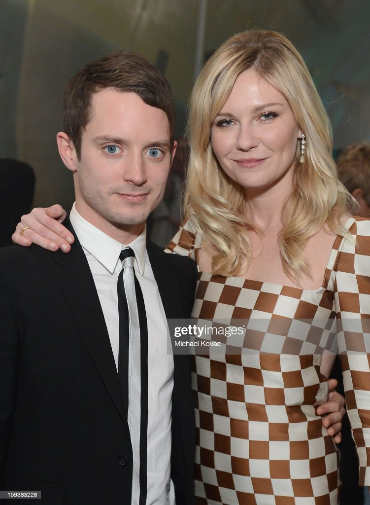 Actors Elijah Wood (L) and Kirsten Dunst attend The Art of Elysium's 6th Annual HEAVEN Gala presented by Audi at 2nd Street Tunnel on January 12, 2013 in Los Angeles, California.