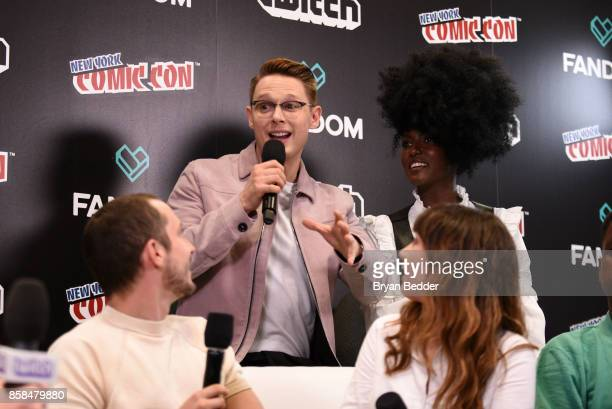 Actors Elijah Wood Sam Barnett Hannah Marks and Jade Eshete speak onstage at the New York Comic Con Live Stage in partnership with FANDOM and Twitch...