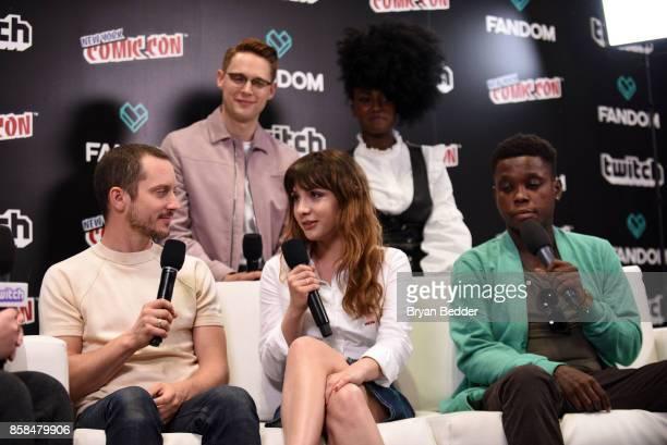 Actors Elijah Wood Sam Barnett Hannah Marks Jade Eshete and Mpho Koaho speak onstage at the New York Comic Con Live Stage in partnership with FANDOM...