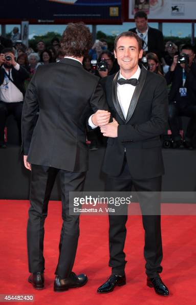 Actors Elio Germano and Michele Riondino attend the 'Il Giovane Favoloso' premiere during the 71st Venice Film Festival at Sala Grande on September 1...