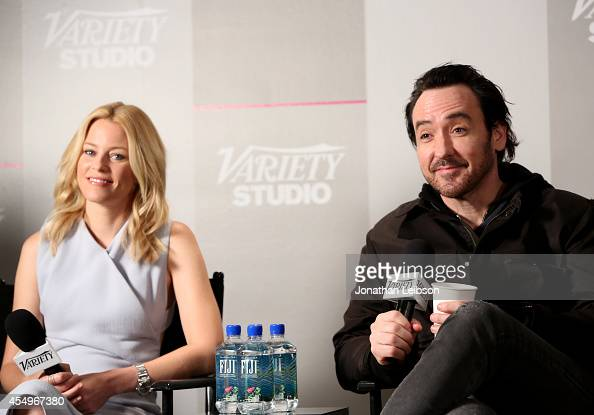 Actors Elizabeth Banks and John Cusack attend the Variety Studio presented by Moroccanoil at Holt Renfrew during the 2014 Toronto International Film...