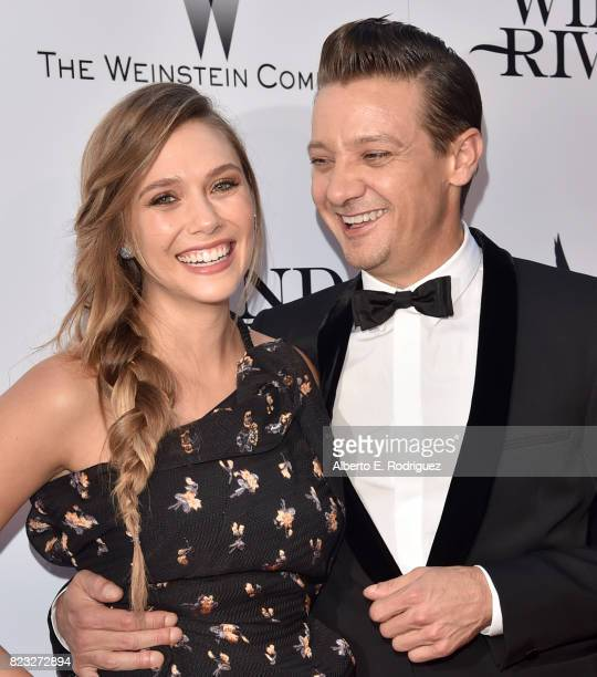 Actors Elizabeth Olsen and Jeremy Renner attend the premiere of The Weinstein Company's 'Wind River' at The Theatre at Ace Hotel on July 26 2017 in...