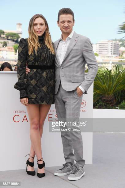 Actors Elizabeth Olsen and Jeremy Renner attend the 'Wind River' photocall during the 70th annual Cannes Film Festival at Palais des Festivals on May...