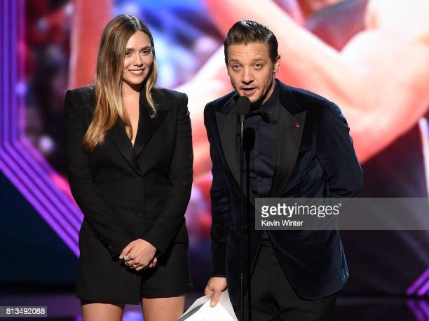 Actors Elizabeth Olsen and Jeremy Renner speak onstage at The 2017 ESPYS at Microsoft Theater on July 12 2017 in Los Angeles California