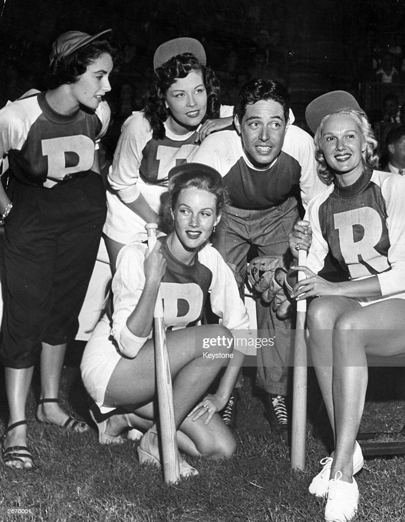 Actors Elizabeth Taylor, Ava Gardner (1922 - 1990), Jack Russell and Carole Richards pose for a group photo after their annual charity softball game in Hollywood to raise money for the youth welfare fund.
