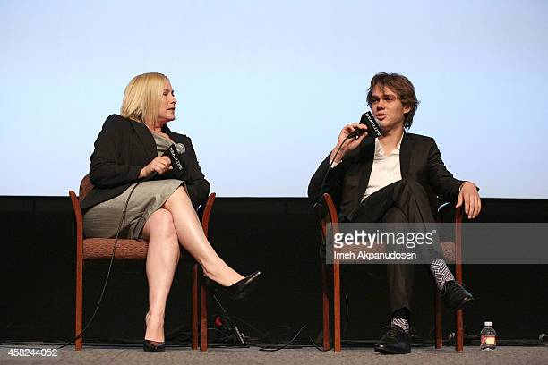 Actors Ellar Coltrane and Patricia Arquette speak onstage during Deadline's The Contenders at DGA Theater on November 1 2014 in Los Angeles California