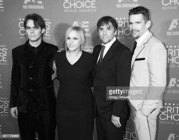 Actors Ellar Coltrane Patricia Arquette director Richard Linklater and actor Ethan Hawke arrive at the 20th Annual Critics' Choice Movie Awards at...