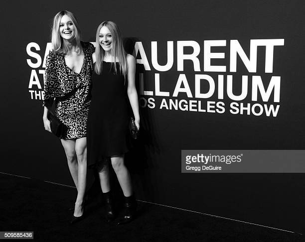 Actors Elle Fanning and Dakota Fanning attend the Saint Laurent show at The Hollywood Palladium on February 10 2016 in Los Angeles California