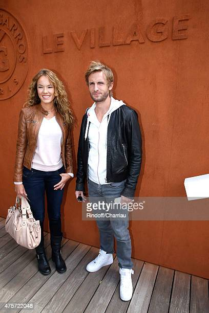 Actors Elodie Fontan and Philippe Lacheau attend the 2015 Roland Garros French Tennis Open Day Eleven on June 3 2015 in Paris France