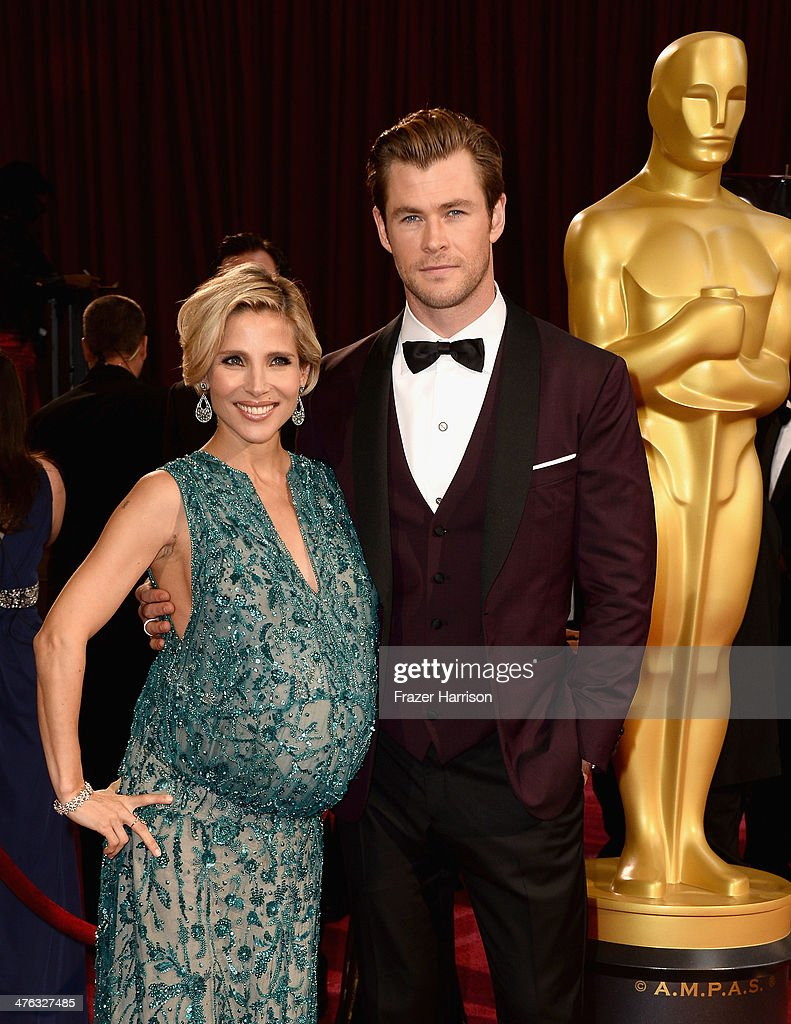 Actors Elsa Pataky (L) and Chris Hemsworth attends the Oscars held at Hollywood & Highland Center on March 2, 2014 in Hollywood, California.