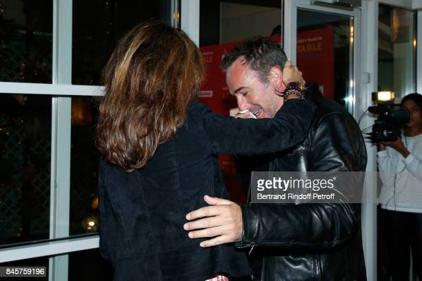 Actors Elsa Zylberstein and Jean Dujardin attend the 'Le Redoutable' Paris Premiere at Cinema du Pantheon on September 11 2017 in Paris France