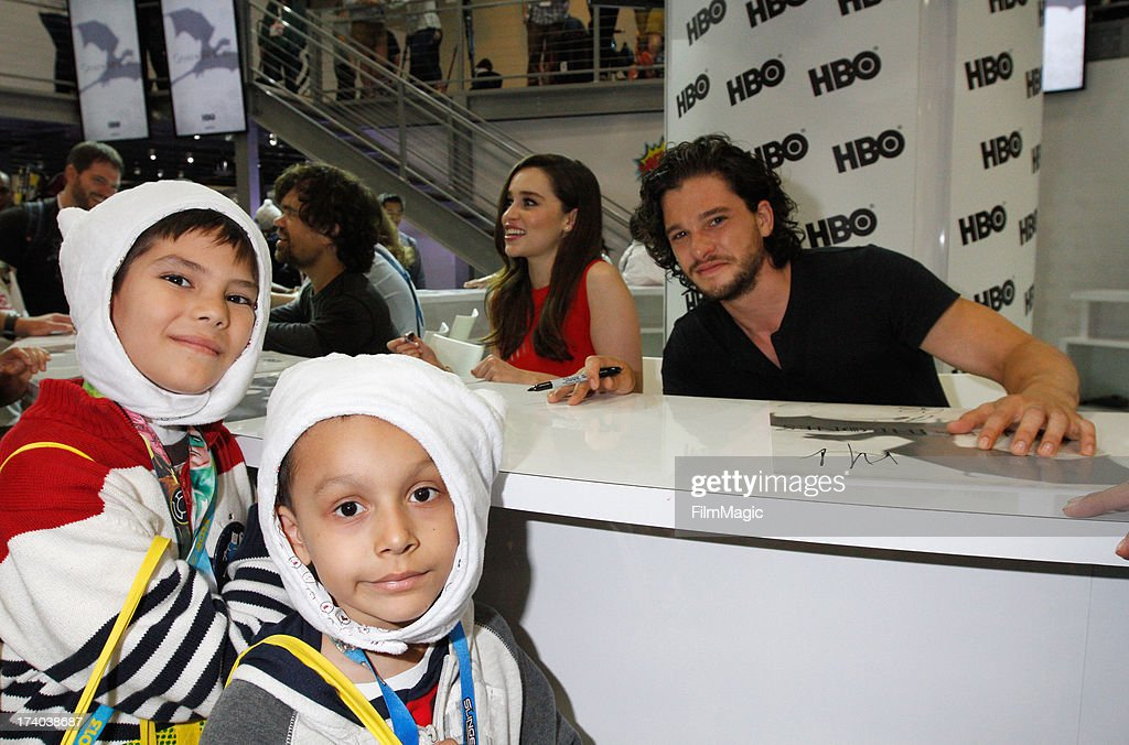 Actors Emilia Clarke and Kit Harington attend HBO's 'Game Of Thrones' cast autograph signing at San Diego Convention Center on July 19, 2013 in San Diego, California.