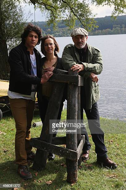 Actors Emilio Sakraya Moutaoukkil Annika Kuhl and Heiner Lauterbach pose during a photocall on set for the film 'Forever Sauerland' on September 25...