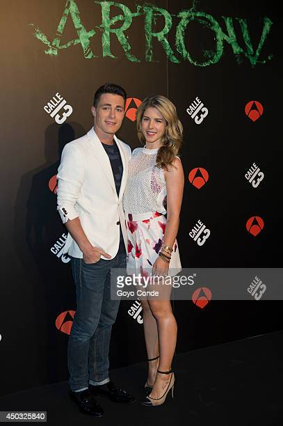 Actors Emily Bett Rickards Colton Haynes attend the 'Calle 13' photocall at the Villamagna Hotel on June 9 2014 in Madrid Spain