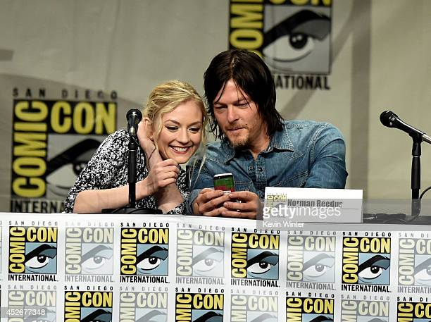 Actors Emily Kinney and Norman Reedus attend AMC's 'The Walking Dead' panel during ComicCon International 2014 at San Diego Convention Center on July...