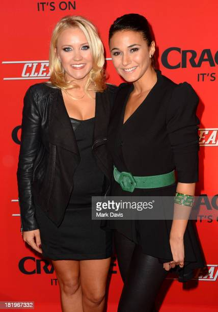Actors Emily Osment and Emmanuelle Chriqui attend the premiere of Crackle's new original digital series 'Cleaners' held at the Cary Grant Theater on...