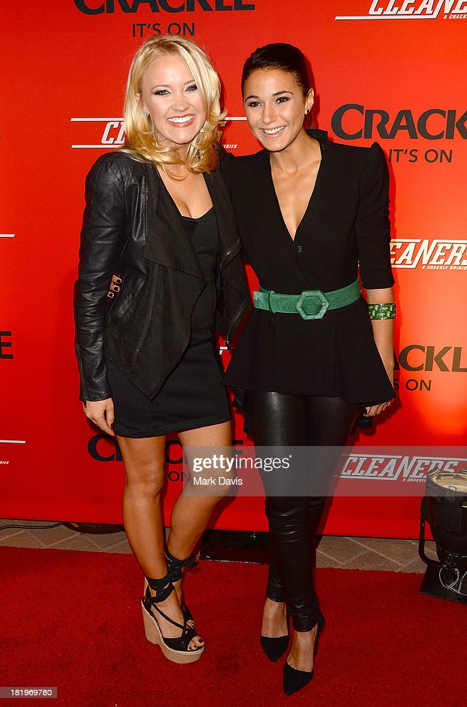 Actors Emily Osment (L) and Emmanuelle Chriqui attend the premiere of Crackle's new original digital series 'Cleaners' held at the Cary Grant Theater on September 26, 2013 in Culver City, California.
