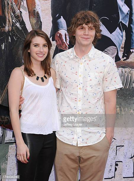 Actors Emma Roberts and Evan Peters arrive at 'The Lone Ranger' World Premiere at Disney's California Adventure on June 22 2013 in Anaheim California
