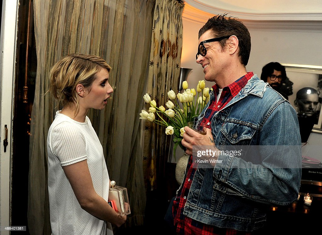 Actors Emma Roberts (L) and Johnny Knoxville talk at the after party for the premiere of Tribeca Film's 'Palo Alto' at the Chateau Marmont on May 5, 2014 in West Hollywood, California.