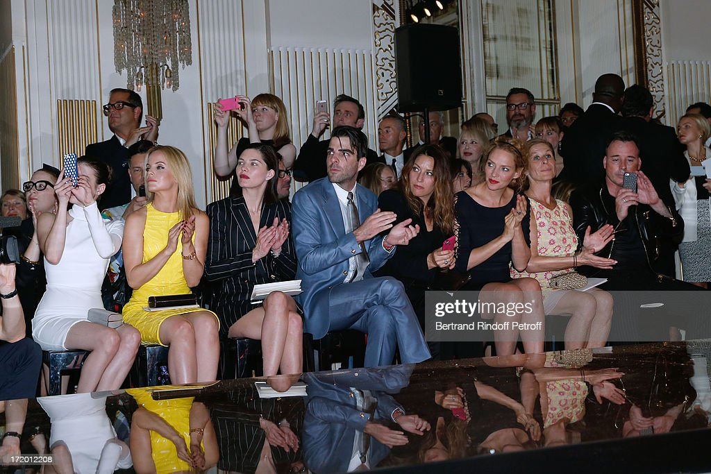Actors Emma Roberts, Mena Suvari, Delphine Chaneac, Zachary Quinto, Guest, Thurman, Jo Levin and David Furnish attend the Versace show as part of Paris Fashion Week Haute-Couture Fall/Winter 2013-2014 at on June 30, 2013 in Paris, France.