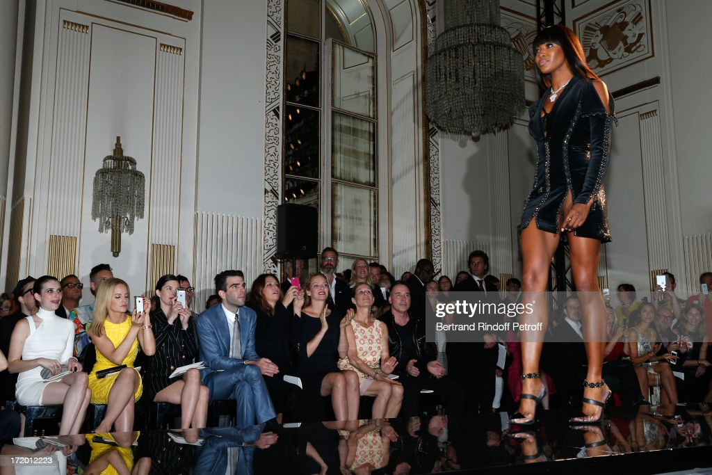 Actors Emma Roberts, Mena Suvari, Delphine Chaneac, Zachary Quinto, Guest, Uma Thurman, Jo Levin and David Furnish watching model Naomi Campbell on the catwalk of the Versace show as part of Paris Fashion Week Haute-Couture Fall/Winter 2013-2014 at on June 30, 2013 in Paris, France.