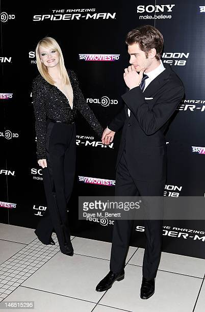 Actors Emma Stone and Andrew Garfield arrive at the UK Premiere of 'The Amazing SpiderMan' at Odeon Leicester Square on June 18 2012 in London England