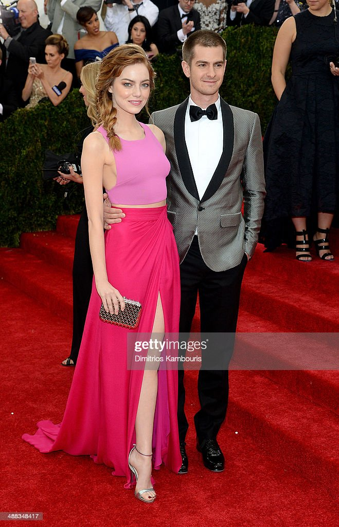 Actors Emma Stone (L) and Andrew Garfield attend the 'Charles James: Beyond Fashion' Costume Institute Gala at the Metropolitan Museum of Art on May 5, 2014 in New York City.