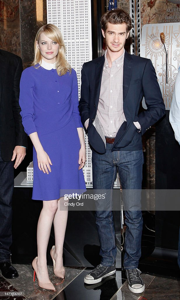 Actors Emma Stone and Andrew Garfield visit The Empire State Building on June 25, 2012 in New York City.