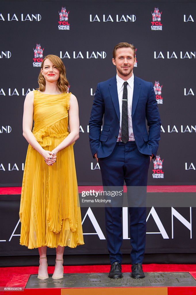 Actors Emma Stone (L) and Ryan Gosling attend 'Ryan Gosling and Emma Stone hand and footprint ceremony' at TCL Chinese Theatre IMAX on December 7, 2016 in Hollywood, California.