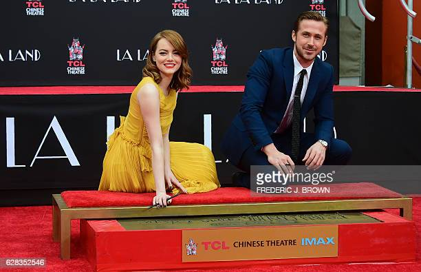 Actors Emma Stone and Ryan Gosling pose at their Hand and Foot print ceremony in front of the TCL Chinese Theater in Hollywood on December 7 2016...
