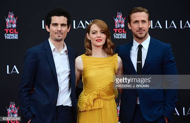 Actors Emma Stone and Ryan Gosling pose with writer and director Damien Chazelle at their Hand and Foot prints ceremony in front of the TCL Chinese...