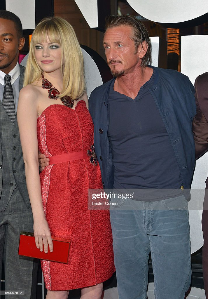 Actors Emma Stone and Sean Penn arrive at the 'Gangster Squad' premiere at Grauman's Chinese Theatre on January 7, 2013 in Hollywood, California.