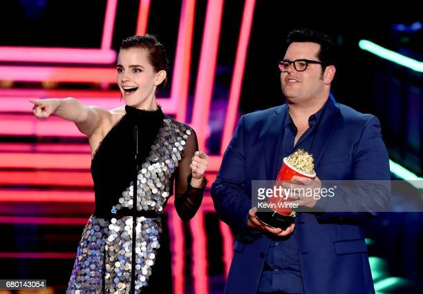 Actors Emma Watson and Josh Gad accept Movie of the Year for 'Beauty and the Beast' onstage during the 2017 MTV Movie And TV Awards at The Shrine...