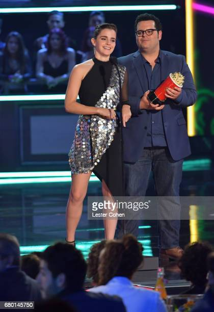 Actors Emma Watson and Josh Gad accept the Movie of the Year award onstage during the 2017 MTV Movie And TV Awards at The Shrine Auditorium on May 7...