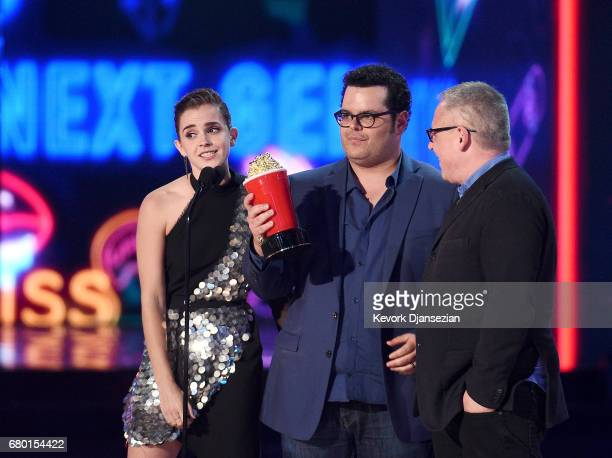 Actors Emma Watson and Josh Gad and director Bill Condon accept the Movie of the Year award for 'Beauty and the Beast' onstage during the 2017 MTV...