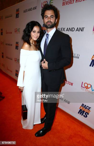 Actors Emmanuelle Chriqui and Adrian Bellani attend the 24th Annual Race To Erase MS Gala at The Beverly Hilton Hotel on May 5 2017 in Beverly Hills...