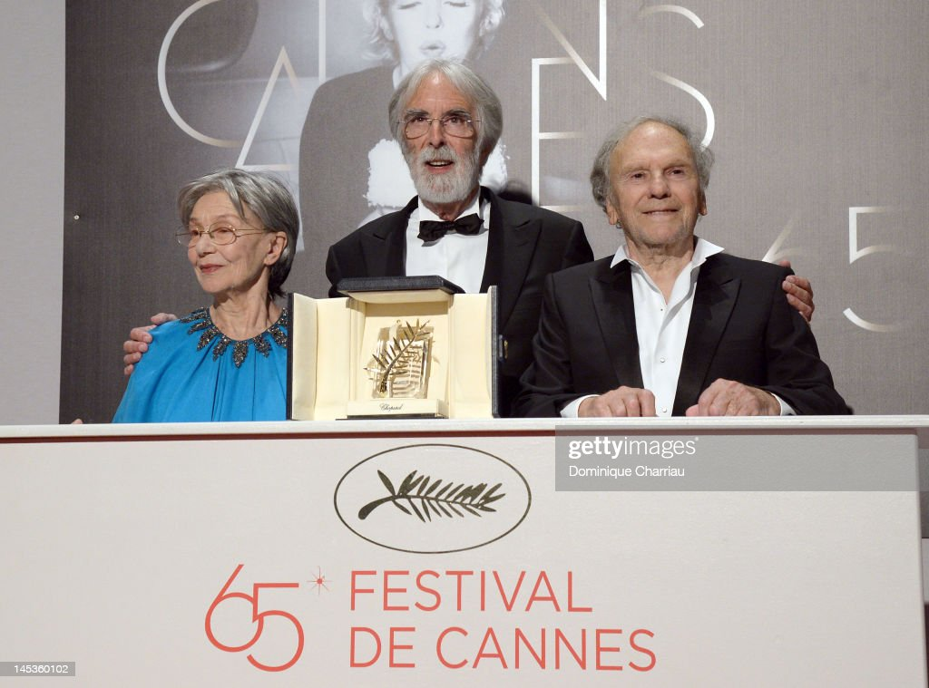 Actors <a gi-track='captionPersonalityLinkClicked' href=/galleries/search?phrase=Emmanuelle+Riva&family=editorial&specificpeople=2029319 ng-click='$event.stopPropagation()'>Emmanuelle Riva</a>, <a gi-track='captionPersonalityLinkClicked' href=/galleries/search?phrase=Jean-Louis+Trintignant&family=editorial&specificpeople=1822183 ng-click='$event.stopPropagation()'>Jean-Louis Trintignant</a> (R) and director <a gi-track='captionPersonalityLinkClicked' href=/galleries/search?phrase=Michael+Haneke&family=editorial&specificpeople=233739 ng-click='$event.stopPropagation()'>Michael Haneke</a> pose with the Palme D?Or for 'Amour' at the Winners Photocall during the 65th Annual Cannes Film Festival at Palais des Festivals on May 27, 2012 in Cannes, France.