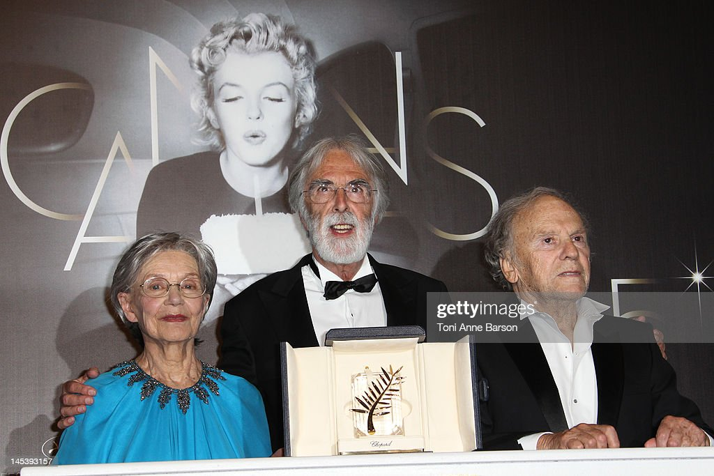Actors <a gi-track='captionPersonalityLinkClicked' href=/galleries/search?phrase=Emmanuelle+Riva&family=editorial&specificpeople=2029319 ng-click='$event.stopPropagation()'>Emmanuelle Riva</a>, <a gi-track='captionPersonalityLinkClicked' href=/galleries/search?phrase=Jean-Louis+Trintignant&family=editorial&specificpeople=1822183 ng-click='$event.stopPropagation()'>Jean-Louis Trintignant</a> (R) and Director <a gi-track='captionPersonalityLinkClicked' href=/galleries/search?phrase=Michael+Haneke&family=editorial&specificpeople=233739 ng-click='$event.stopPropagation()'>Michael Haneke</a> pose with the Palme D'Or for 'Amour' at the Winners Photocall at Palais des Festivals on May 27, 2012 in Cannes, France.