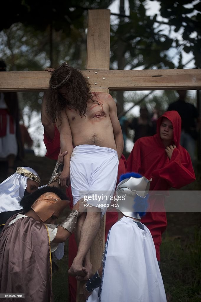 Actors enact the Via Crucis procession along the streets of Medellin, Antioquia department, Colombia, as part of Good Friday ceremonies on March 29 , 2013. AFP PHOTO/Raul ARBOLEDA