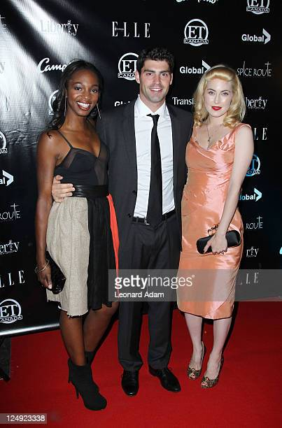 Actors Enuka Okuma Gregory Smith and Charlotte Sullivan attend ET Canada's Red Carpet Event at Spice Route during the 2011 Toronto International Film...